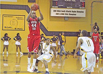 Ellison and the WSSU Rams move the ball up court against the JCSU full court press. Photo: Urban News