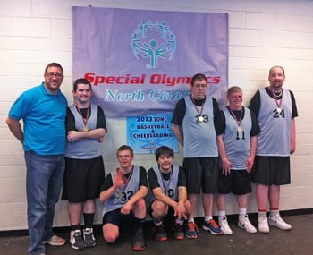 The Special Olympics Basketball Team, the Buncombe Ice. From left to right: Sidney Blakely, Tyler Ayers, Elijah Kiddy, Alex Pott, Rob Powell, and Robert Walker, and coach Aaron Naster. Photo taken at the SONC Western Basketball Final Tournament.