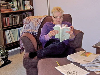 Beth enjoys her cozy reading space  in the bedroom.