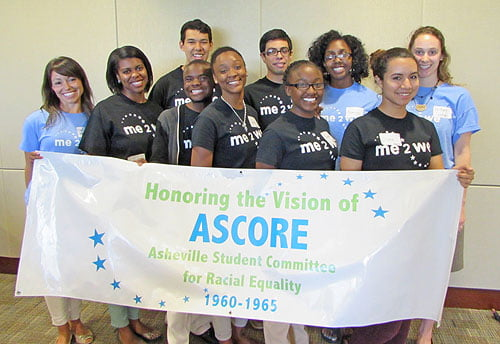 Pictured are students from Asheville High School's AVID program, along with past and present members of the Me2We program. The success of this program has led many of the students to continue on to higher education at colleges and universities.   Photo: Urban News