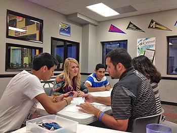 Savanna Clark (second from left) works with teens in the Boys and Girls Club after-school program.