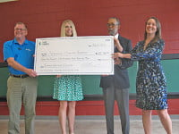 (L-R): Kevin Brock, Outreach Account Manager, Duke Energy; Paula Clark, Account Executive, Duke Energy; Gene Bell, CEO, Asheville Housing Authority; and Samantha Bowers, Project Manager, Asheville Housing Authority.