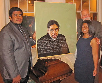 Two of Dr. William Barber's children, Benjamin Barber (at left), and Rebecca Barber, were on hand at the unveiling of the portrait created by Robert Shetterley (right).  Photo: Moe White/Urban News