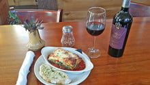 Chef Frank Hayden's spinach-and-roasted-red-pepper lasagna with béchamel sauce, Italian bread, and  (of course!) Italian wine.  Photo: Urban News