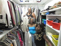 Preparing the clothes closet are volunteers Linda Jackson (top back), Patricia Borden (center), and (front) Stephanie Maewether, founder of the Forever Living Clothes Closet.  Photo: Urban News
