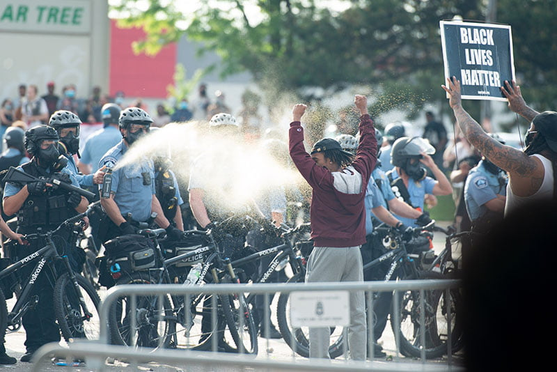 Minneapolis police pepper spray a protestor