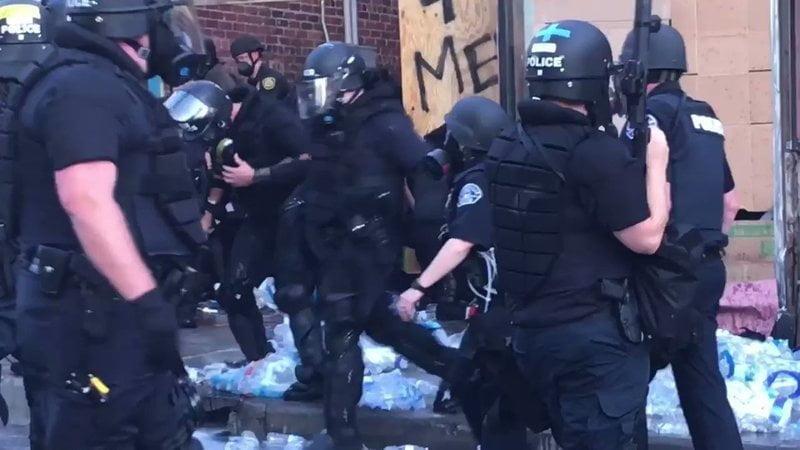 Police violently destroy bottles of water.