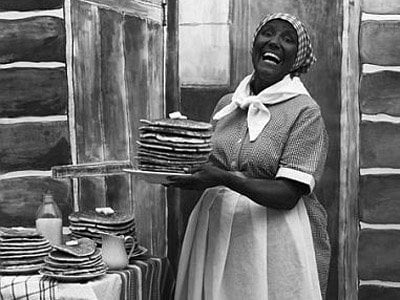Aunt Jemima was based on a caricature that Nancy Green, a black woman, was hired to portray.
