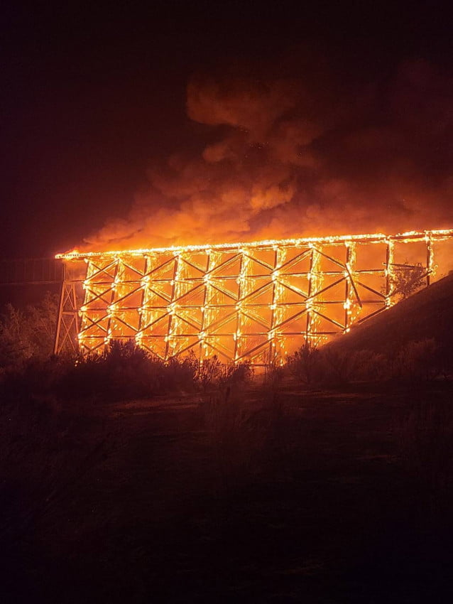A train bridge over the Yakima River caught on fire. Photo by by Brian Stott.