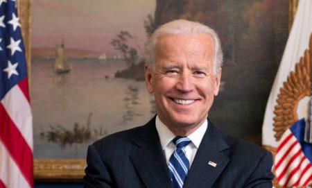 Joe Biden in front of flag