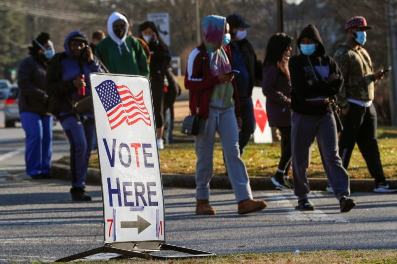 Voters line up at a polling place
